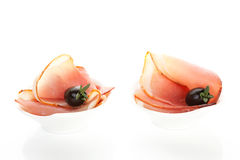 Delicious ham canape on white. Royalty Free Stock Photo