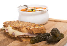 Delicious ham, pork and swiss cheese panini with vegetable soup Royalty Free Stock Image