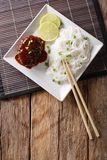 Delicious hambagu steak with gravy and rice vermicelli close-up Stock Photo