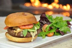 Delicious hamburger. Hamburger from the grill with salad Royalty Free Stock Images