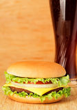 Delicious hamburger on brown paper on a wooden tabletop Royalty Free Stock Photos