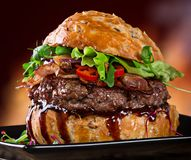 Delicious hamburger. On dark background Stock Photography