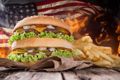 Delicious hamburger with fire flames Stock Images