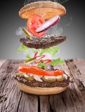 Delicious hamburger with flying ingredients Stock Image