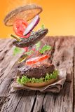 Delicious hamburger with flying ingredients Stock Photography