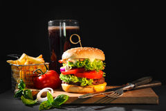 Delicious hamburger with French fries Royalty Free Stock Image
