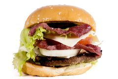 Delicious hamburger with juicy bacon. Image of delicious hamburger with juicy bacon, isolated on white background Stock Image