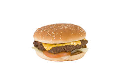 Delicious hamburger with tomato and lettuce. Delicious hamburger on a white sesame seed bun. The meat is covered by melted cheese and the burger also contains royalty free stock photo