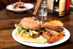 Delicious hamburger. With wedge cut french fries Stock Photography