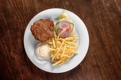 Delicious hamburger on white plate Royalty Free Stock Photography