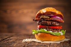 Delicious hamburger on wood Stock Photos