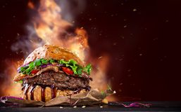 Delicious hamburger on wood Stock Images