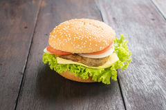 Delicious hamburger on wooden background Stock Photography