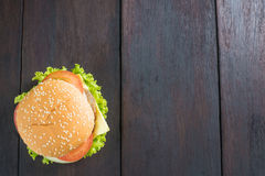 Delicious hamburger on wooden background, shot from upper view Royalty Free Stock Image