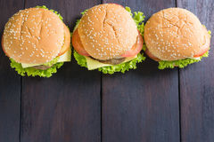 Delicious hamburger on wooden background, shot from upper view Royalty Free Stock Photography