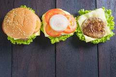 Delicious hamburger on wooden background, shot from upper view Royalty Free Stock Photos