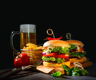 Delicious hamburgers with french fries Royalty Free Stock Photography