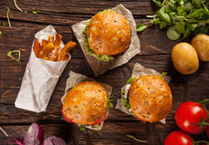 Delicious hamburgers on wood Stock Photo