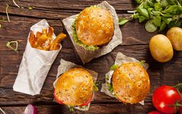 Delicious hamburgers on wood. Takeaway food. stock images