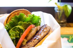 Delicious hamburgher classic with burgher, tomato, lettuce, and roasted onion stock photos