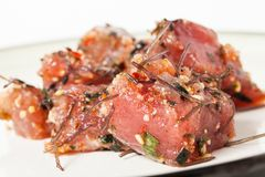 Delicious Hawaiian Poke Raw Fish Prepared with Onions and Seaweed royalty free stock photos