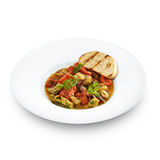 Delicious healthy backed rapana meat served with tomatoes Stock Image