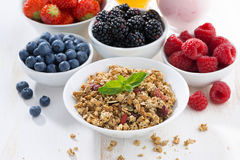 Delicious and healthy breakfast with berries on white wood Stock Photo