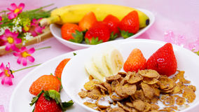 Delicious healthy breakfast cornflakes with strawberry and banan Royalty Free Stock Image