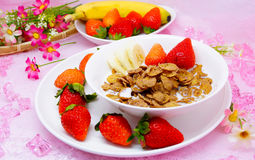 Delicious healthy breakfast cornflakes with strawberry and banan Stock Images