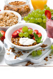 delicious and healthy breakfast with fruits, granola, milkshake Royalty Free Stock Photo