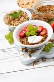 delicious healthy breakfast with fruits, granola on white Royalty Free Stock Photos