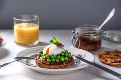 Delicious and healthy breakfast - sandwich with onion jam, poached egg  vegetables Royalty Free Stock Images