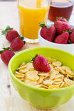 Delicious and healthy breakfast with strawberry and cornflakes Royalty Free Stock Images