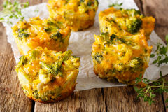 Delicious and healthy broccoli bites with cheddar cheese, egg an. D thyme close-up on the table. horizontal Royalty Free Stock Photography