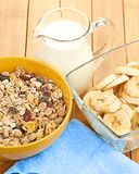 Delicious and healthy cereal in bowl with milk Stock Photo