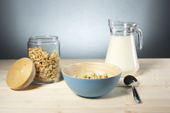 Delicious and healthy cereal in bowl with milk on table Stock Images