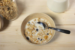 Delicious and healthy cereal in bowl with milk on table Stock Photo