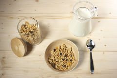 Delicious and healthy cereal in bowl with milk on table Royalty Free Stock Photography