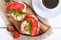Delicious healthy dietary breakfast: rye bread with cottage cheese and strawberries Royalty Free Stock Photo