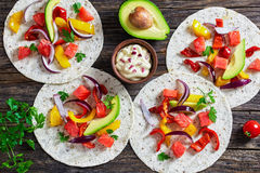 Delicious healthy fajitas with chunks of smoked salmon Royalty Free Stock Photography