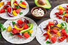 Delicious healthy fajitas with chunks of smoked salmon Royalty Free Stock Photo