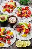 Delicious healthy fajitas with chunks of smoked salmon Stock Photos