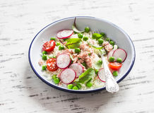 Delicious healthy food - salad with cous cous, fresh vegetables and baked salmon. Royalty Free Stock Photography