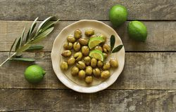 Delicious healthy green olives on a plate. stock photos