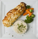 Delicious healthy grilled fish fillet served on a platter with a Stock Image