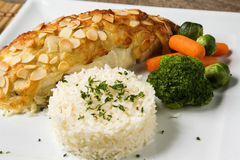 Delicious healthy grilled fish fillet served on a platter with a Stock Photo