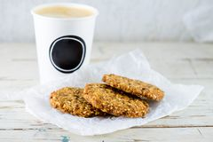 Delicious healthy oatmeal cookies with lime and cup of fresh cof. Fee on the wooden background with copyspace for text stock images