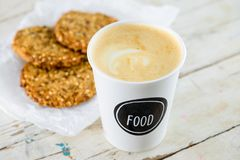 Delicious healthy oatmeal cookies with lime and cup of fresh coffee on the wooden background royalty free stock image