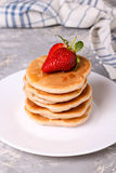 Delicious healthy pancakes with strawberries on white plate Royalty Free Stock Photography
