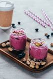 Delicious healthy pink smoothie with granola nuts. And berries stock photos